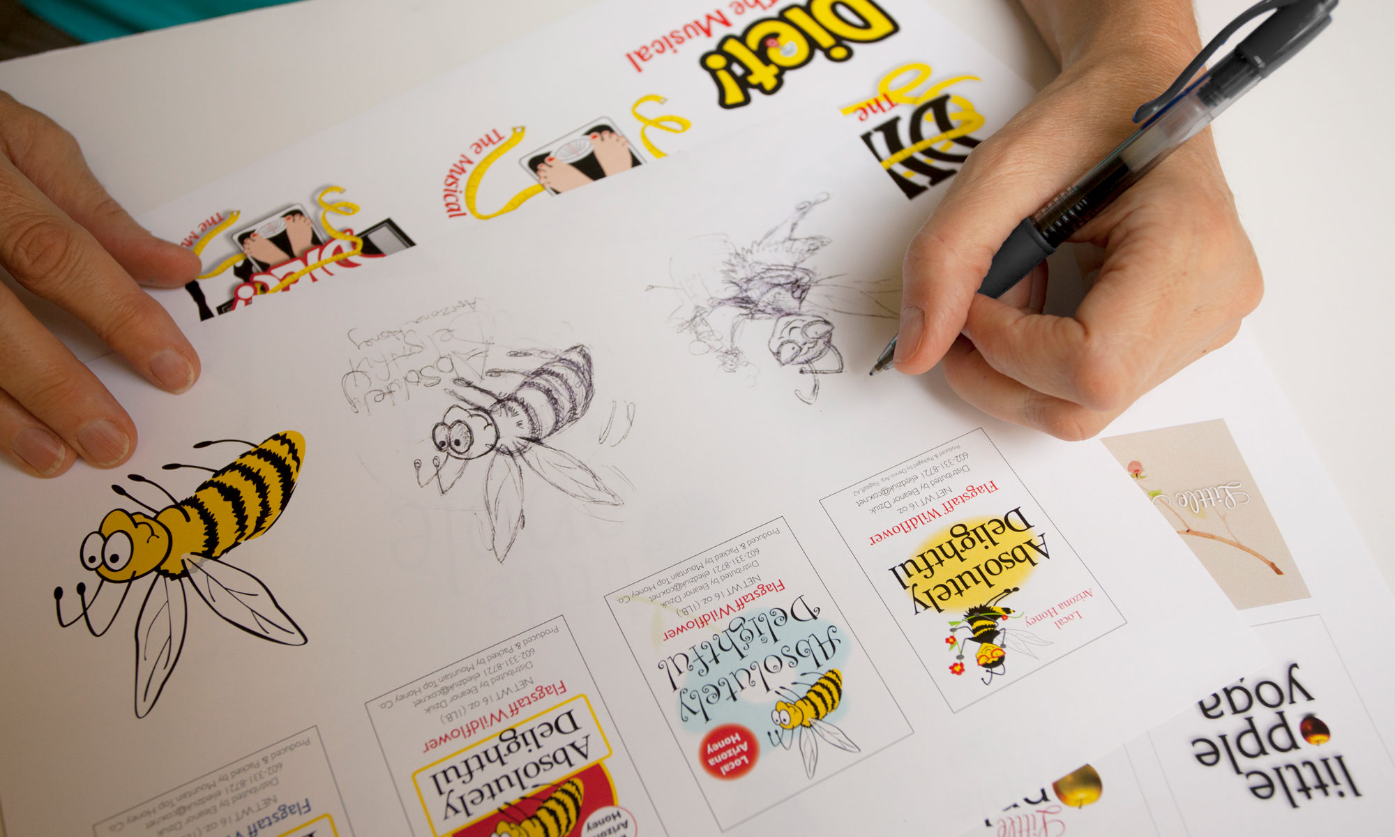 artist drawing a girl bee logo