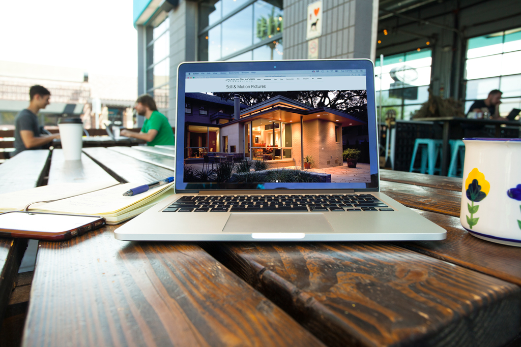 laptop on picnic table at coffee shop